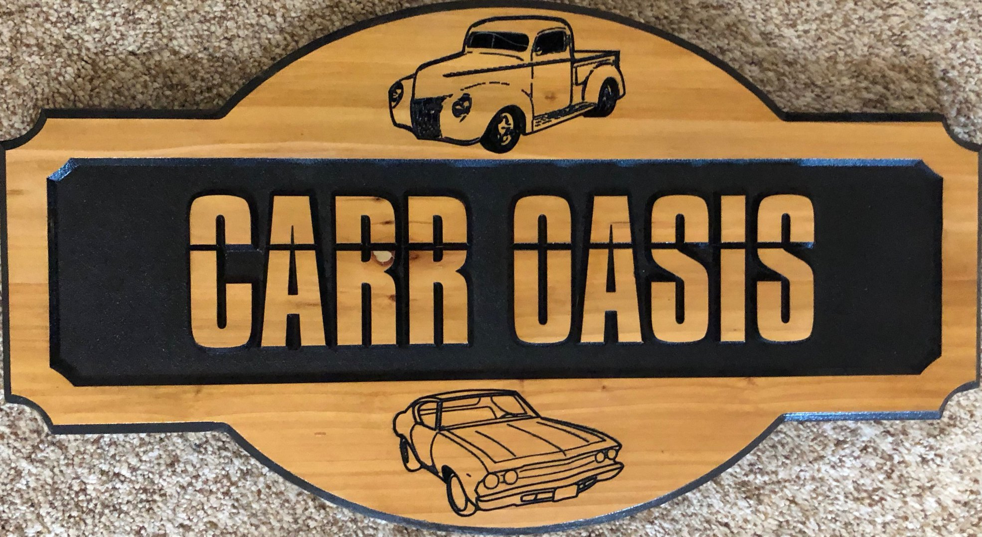 606  wooden name sign with car graphics