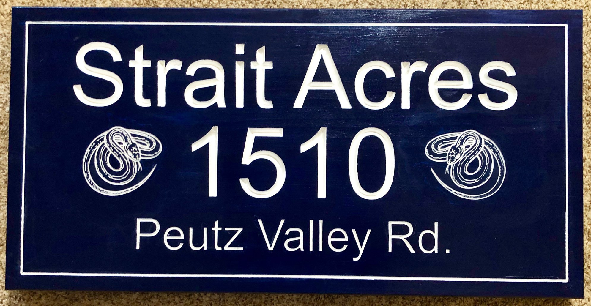 "611  wood address sign for ""Strait Acres"" with snake carving"