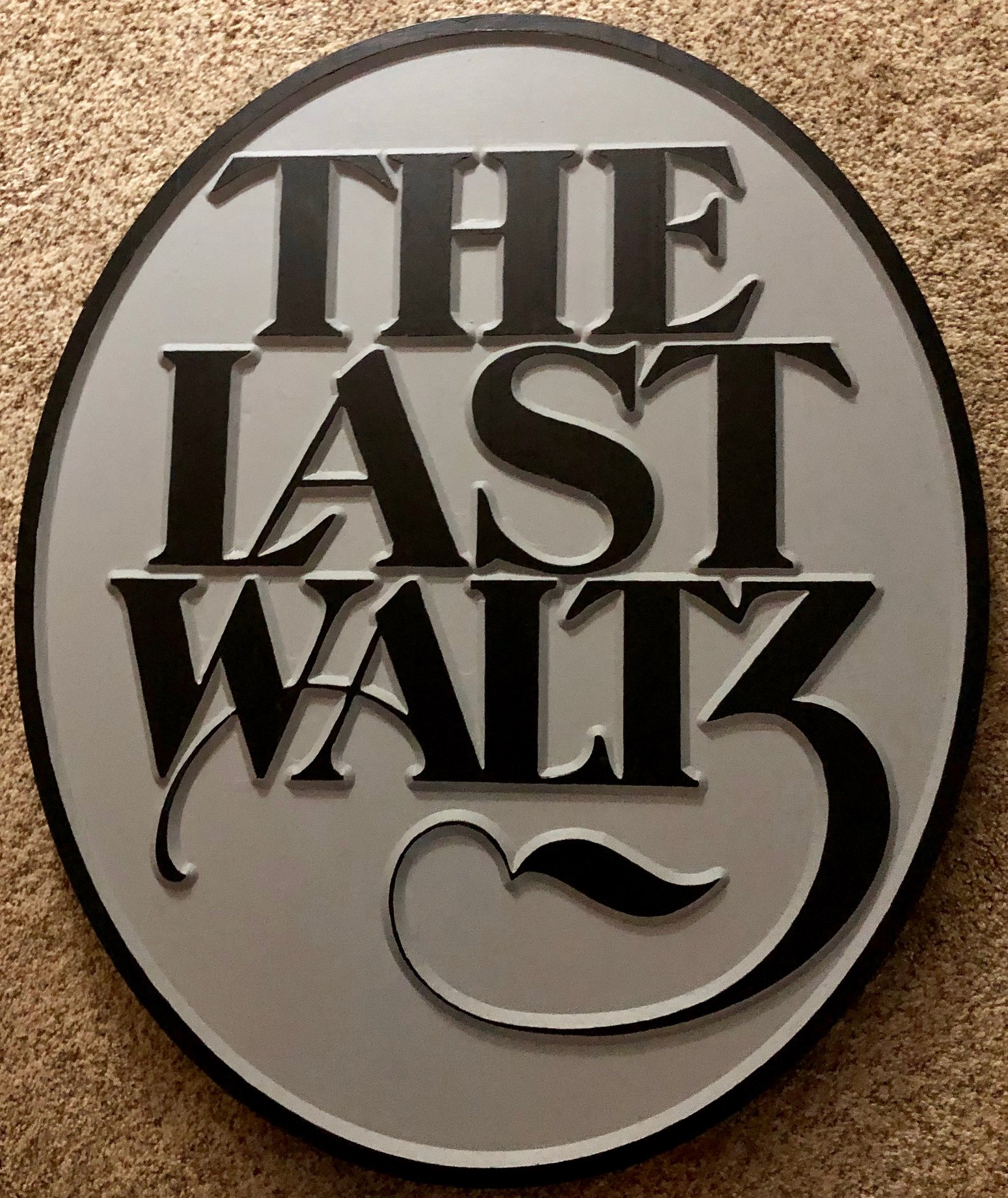 "614  oval recessed wood carving with words ""the last Waltz"""