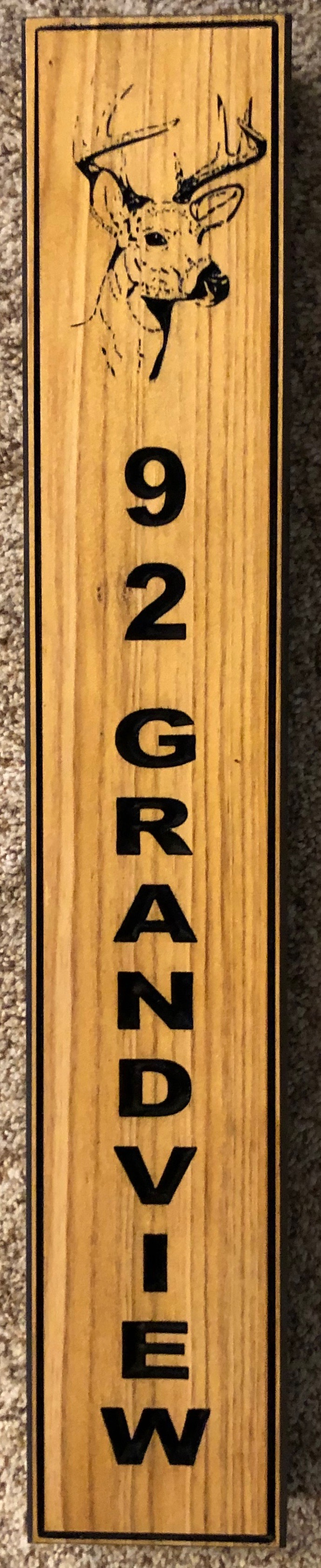 615  vertical wood sign with street address and deer graphic