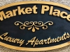 604  recessed wood carving name sign for apartment complex