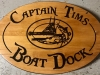 607  carved wood boat dock address sign with boat carving