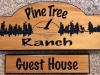 """613  Pine tree ranch wood sign with forest scene and hanging sign """"guest House"""""""